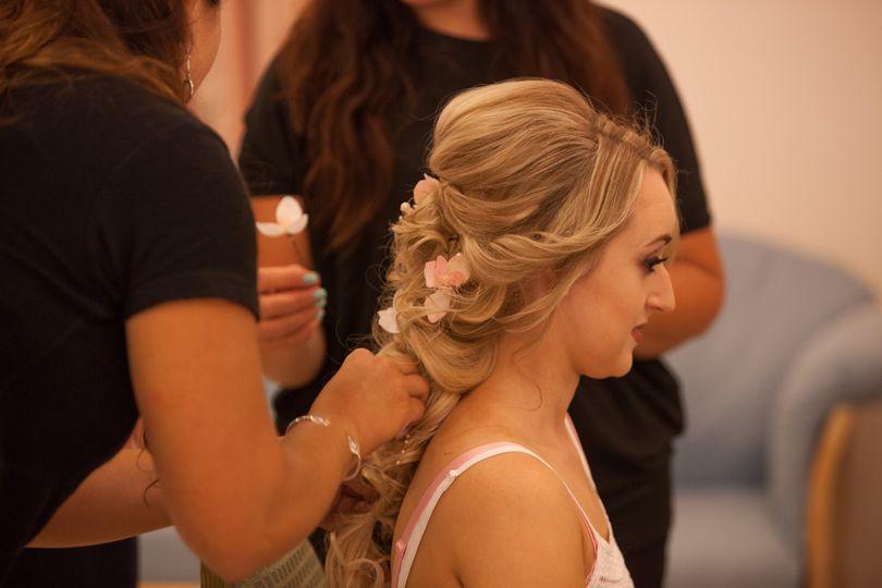 Braiding her hair