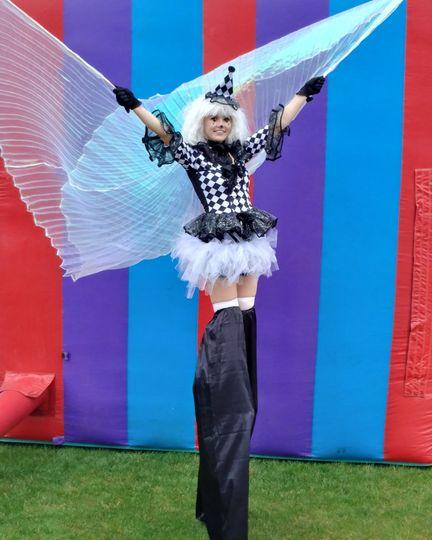 Black and white clown stilt walker