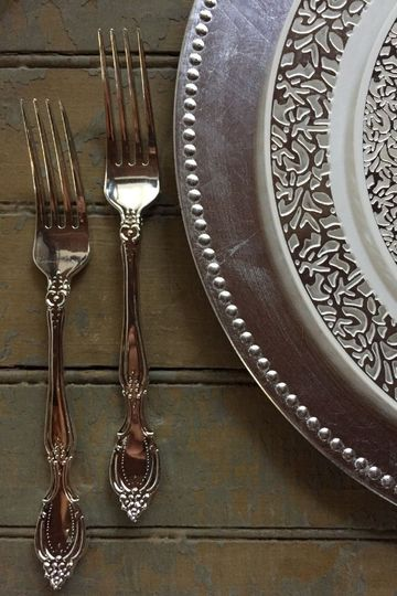 This is our Lace Trim Collection with our Baroque flatware in silver!  Our classic silver charger...