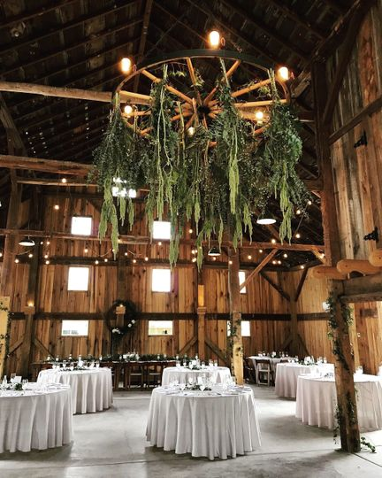 Barn wedding meets classic elegance!  Our white tablecloths look gorgeous in this setting, don't you...