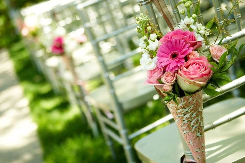 Aisle chair floral accents in the wedding gardens