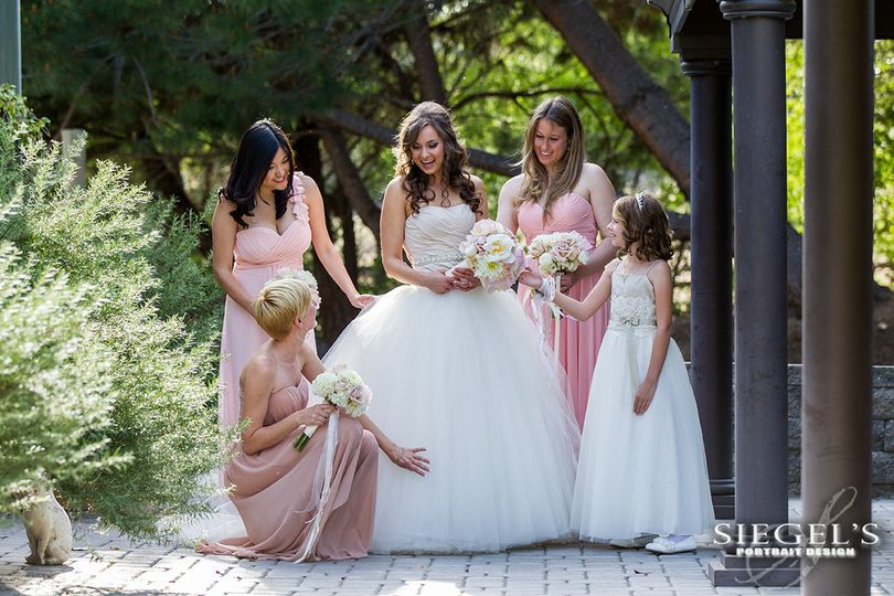 Bride and her bridesmaids in the gardens before the ceremony