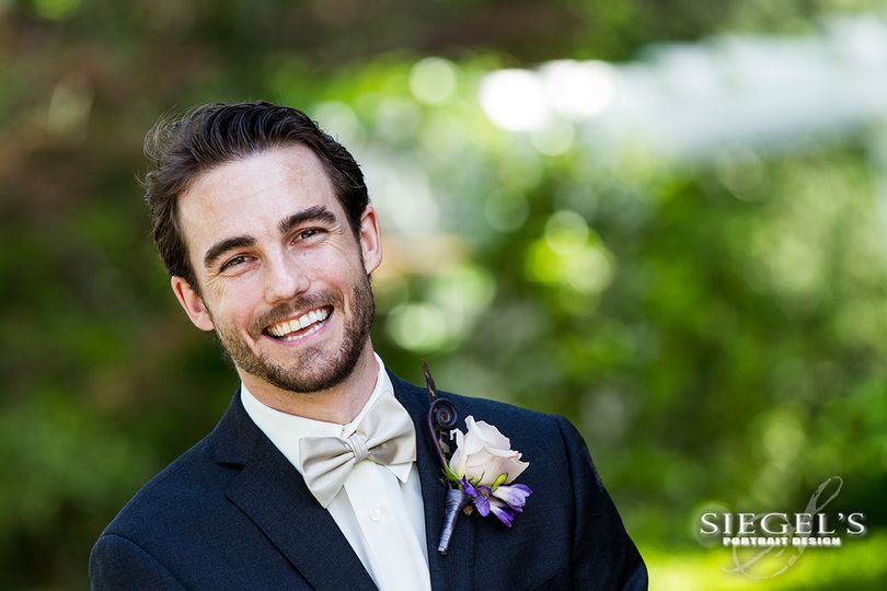 A great smile from this happy groom!