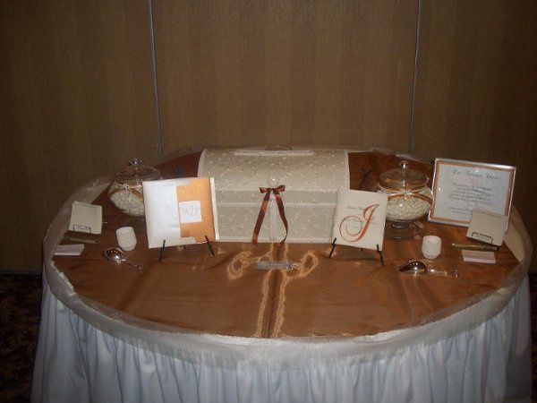 Gift table with custom ceremony programs, candy jars, wedding wish cards designed by AWUD.