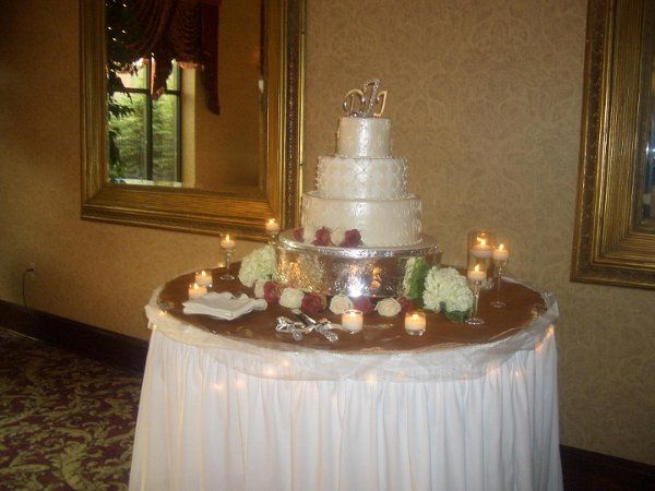 Cake table with floating candles.