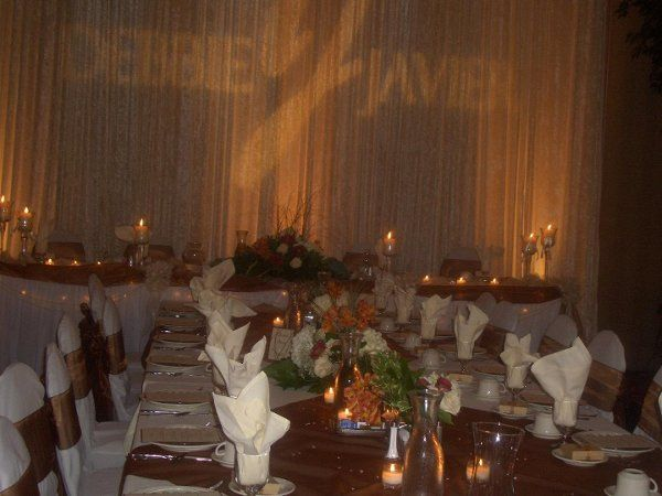 Head table with lighted backdrop & monogram.