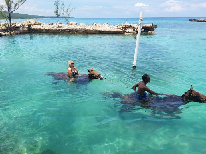 Jamaica! If you go to Jamaica, try horseback riding along the beaches and in the ocean! Great...