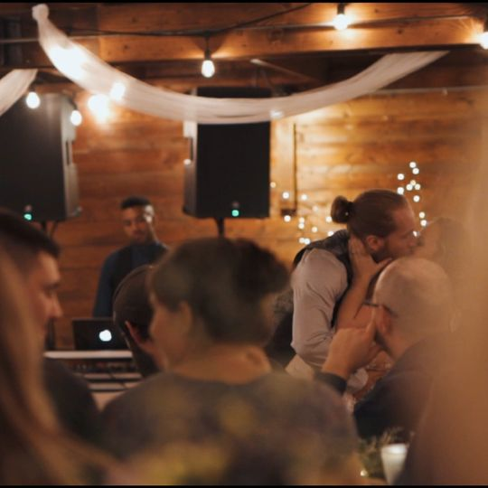 Wedding couple stealing kisses