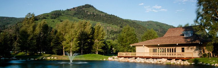 Stunning views of the magnificent Colorado Rocky Mountains, pond, sweeping lawn and full caterer's...