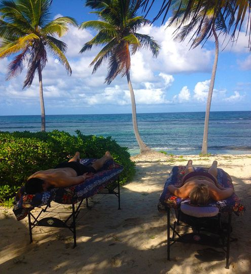 Romantic Couples Massage on the Beach at Palms at Pelican Cove