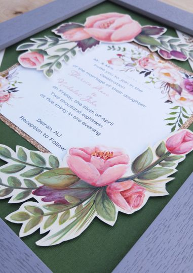 Hand painted and hand cut details show off your invitation