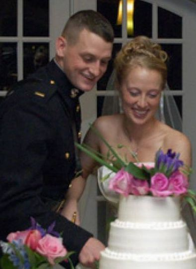 Couple slicing the cake