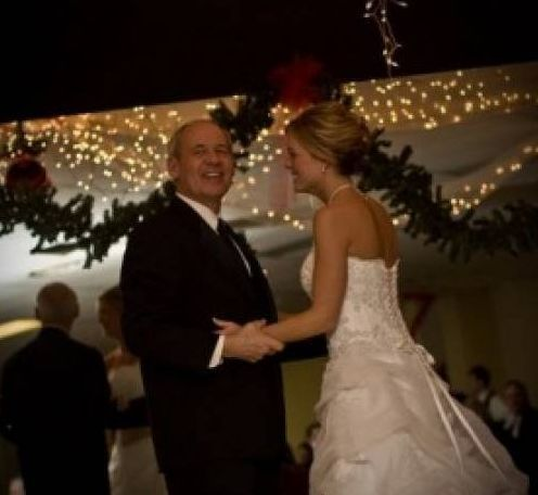 Daughter and father dancing
