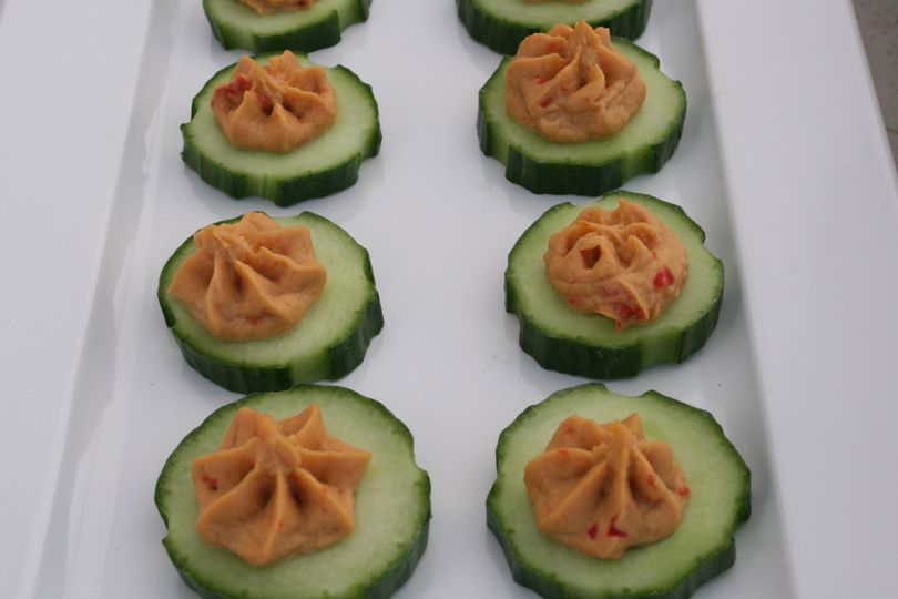 Red Pepper Hummus on cucumber round