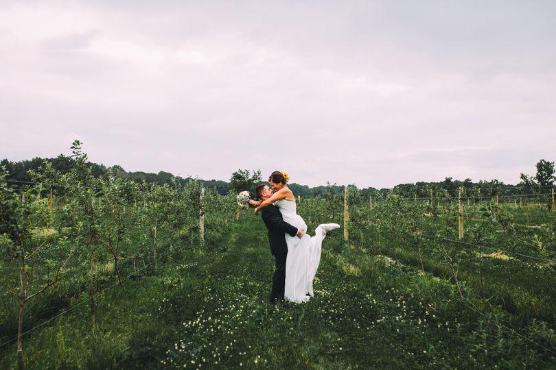 Groom lifting and kissing his bride