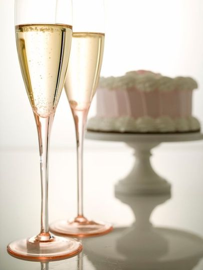 Glasses of wine and wedding cake