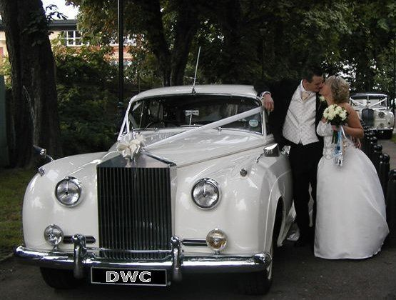 Rolls Royce with bride & groom