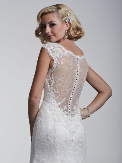 Leave them wanting more in stunning bridal gowns that feature jeweled and illusion or bare back...
