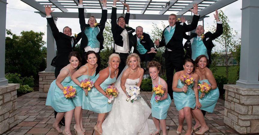 The couple with their wedding parties