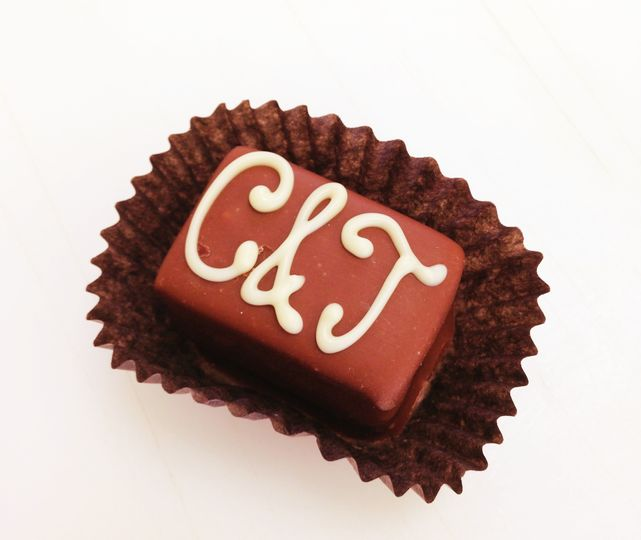 Piping monogram shown. We offer milk chocolate, dark chocolate and white chocolate piping.