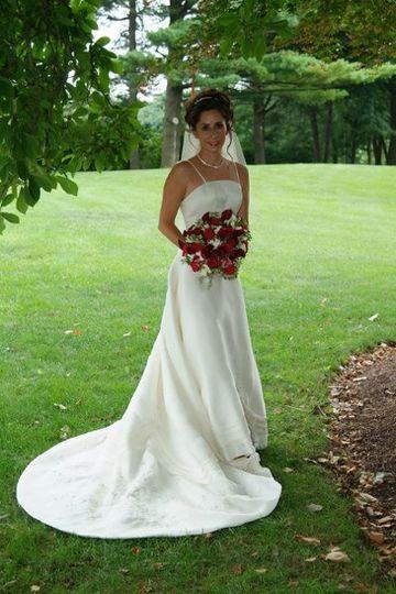 Sharon Hoffman wearing a Matthew Christopher wedding gown.