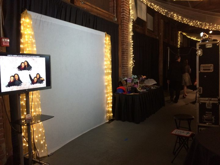 Typical setup: backdrop, 8ft table for all the fun props, monitor to stream all the pictures live as...