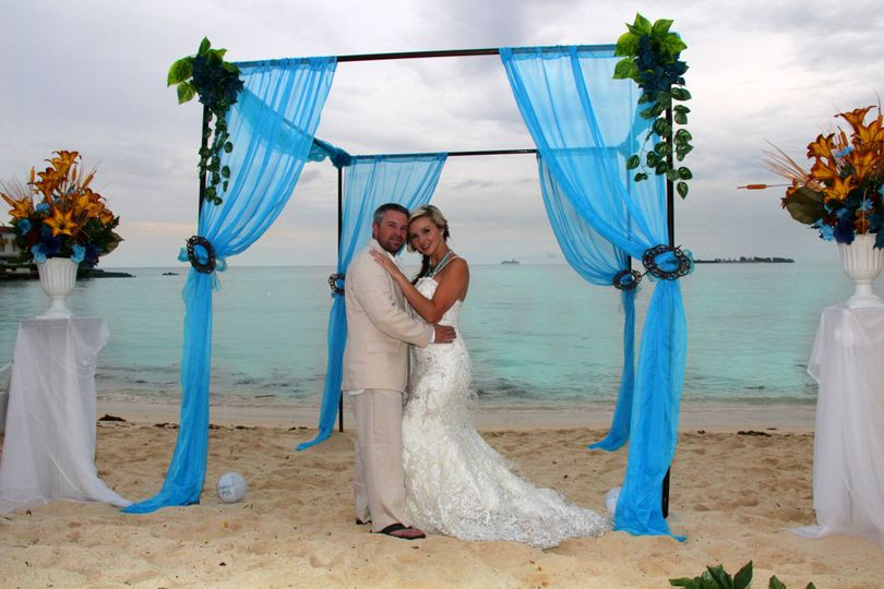 A gorgeous draped decorated chuppah will be the center attraction. Choose your color theme and we...