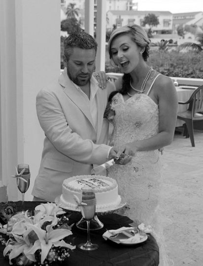 First cut of cake as husband and wife, oh what a wonderful experience.