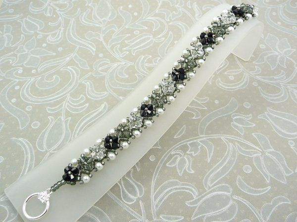 Crystal and Pearl Bracelet woven with Swarovski in Black, black diamond and clear crystal.  Bordered...