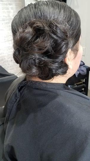 Low curly side-bun