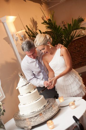 Newlyweds slicing the cake