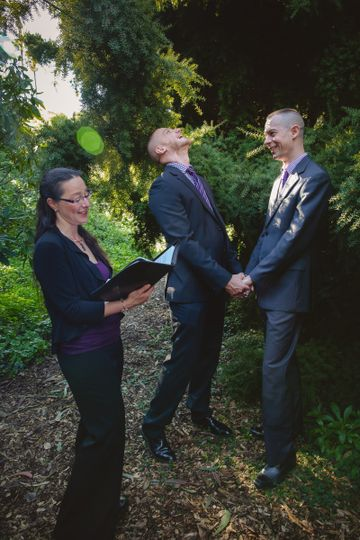 Grooms with the officiant