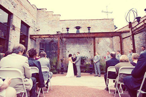 Ceremony at Blumen Gardens photo by Kristin Kasperek of iKliKphoto