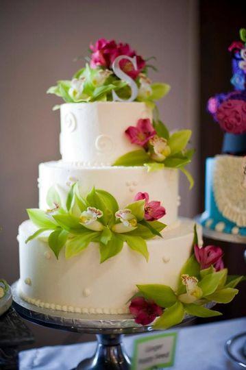 Three-tier wedding cake with flowers