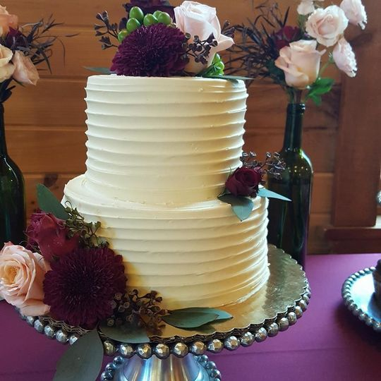 Two-tier wedding cake with flowers