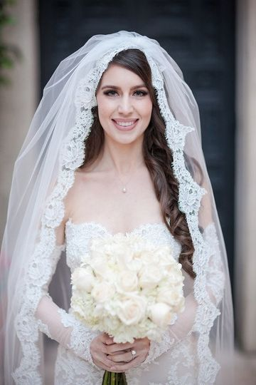 Sleeved bridal gown and veil