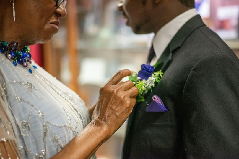 Mother putting flower on son