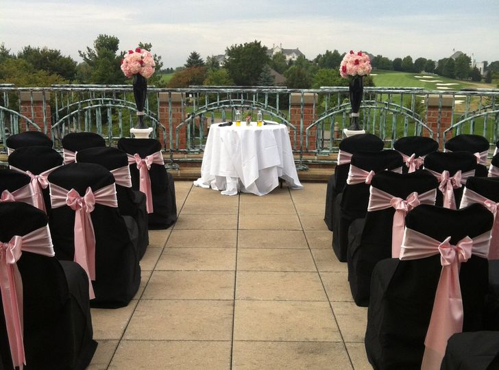 elegant black and pink outdoor ceremony site
