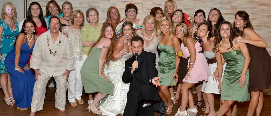 DJ Buddy gets in on the action with the bride and all the girls for a group shot at Royal Fiesta of...