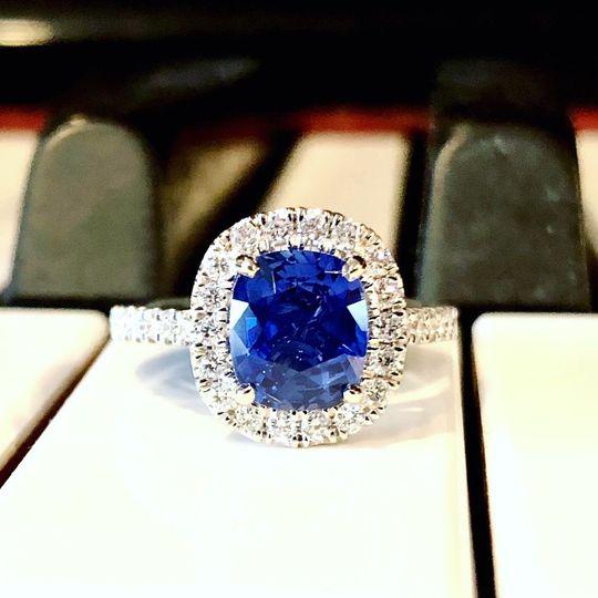 Ceylon Blue Sapphire surrounded by a diamond halo.
