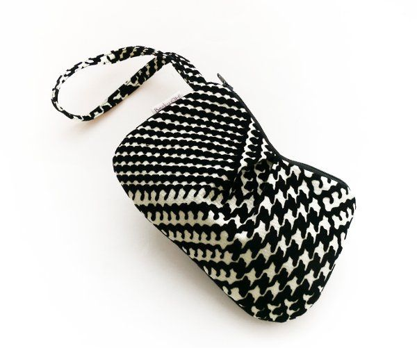 Pleated Pequenyo wristlet in a brushed velvet houndstooth fabric.