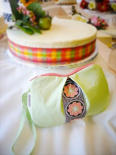 Pleated Pequenyo wristlet in Irish linen and a woven ribbon accent.