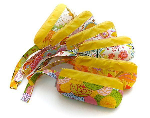 Apropos wallet-sized bags coordinate with the yellow and floral wedding theme.