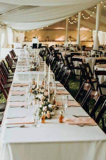 Long table setup with peach napkins