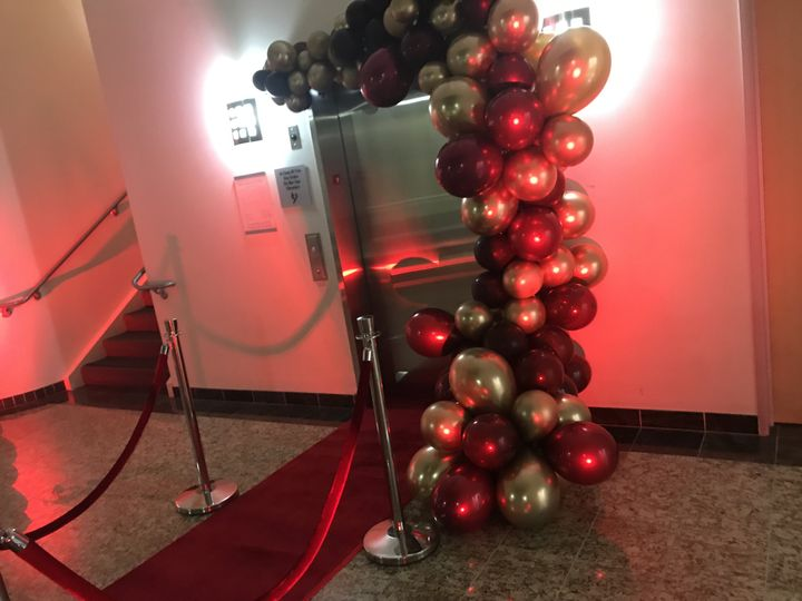 Balloon garland and red carpet