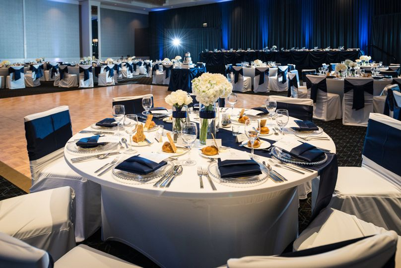 Reception Table Centerpieces Designed by L.A. Flowers, Inc.   Hotel Arista Naperville Wedding...