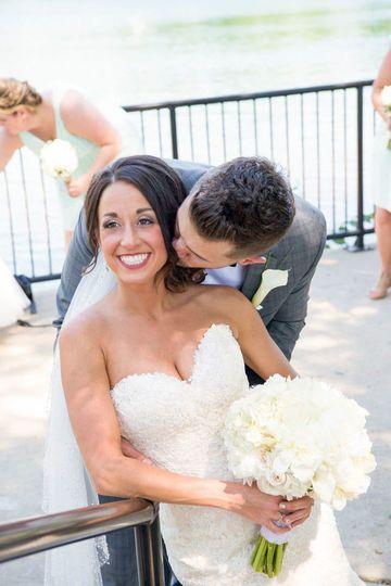 Bridal bouquet and boutonniere Designed by L.A. Flowers, Inc.  Noah's Event Venue Naperville...