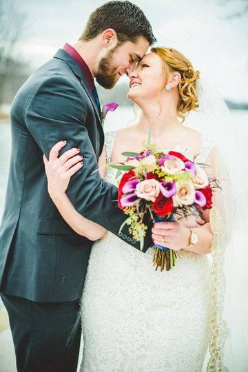 Bridal bouquet and boutonniere designed by L.A. Flowers, Inc.   Whitetail Ridge Golf Club Wedding in...