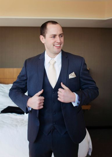 Groom wearing Michael Kors Slim Fit Suit in Navy