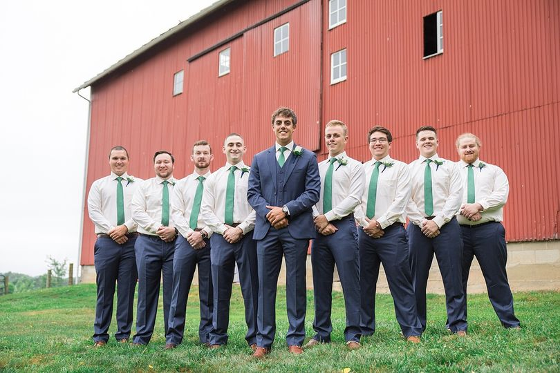 Bridal party beside a barn